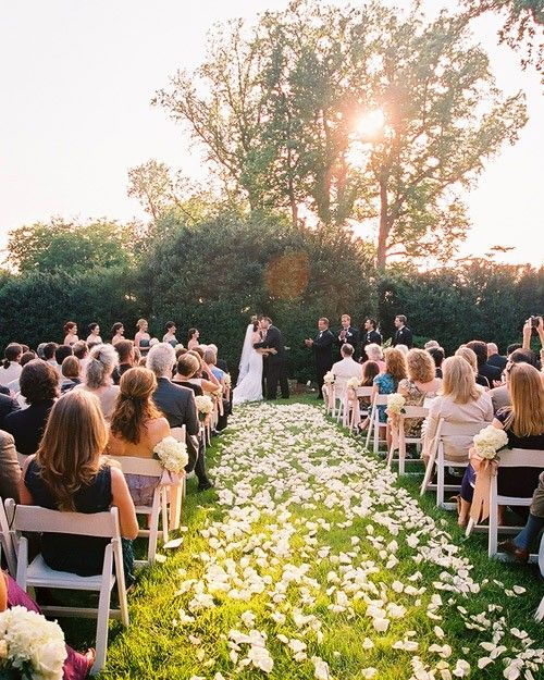 An aisle strewn with white petals was this couple's way of paying homage to spring at their wedding in Charlottesville, Virginia.
