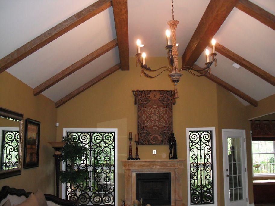A luxurious ceiling design created with faux wood beams plus DIY staining  tips