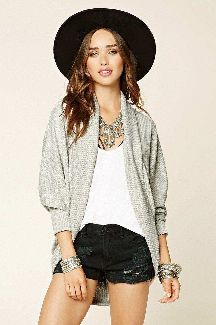 A knit cardigan featuring a shawl collar, long cuffed batwing ...