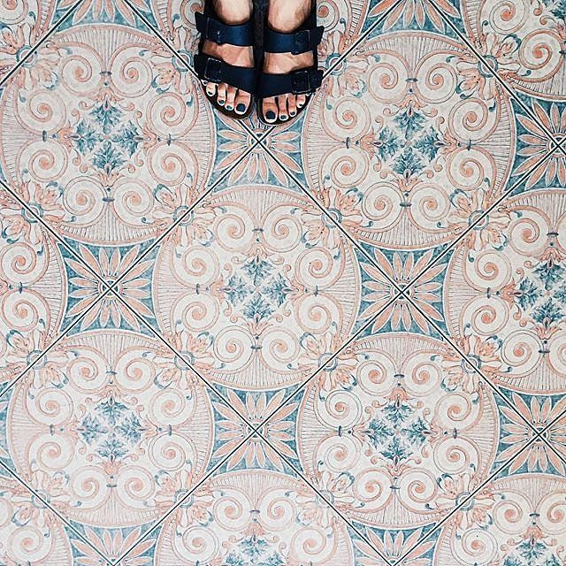 The phenomenon of snapping photos of beautiful floors, sometimes featuring feet or furniture, has officially gone viral. There's definite allure in the faded tiles at Italy's Hotel Terme Principe in Ischia.