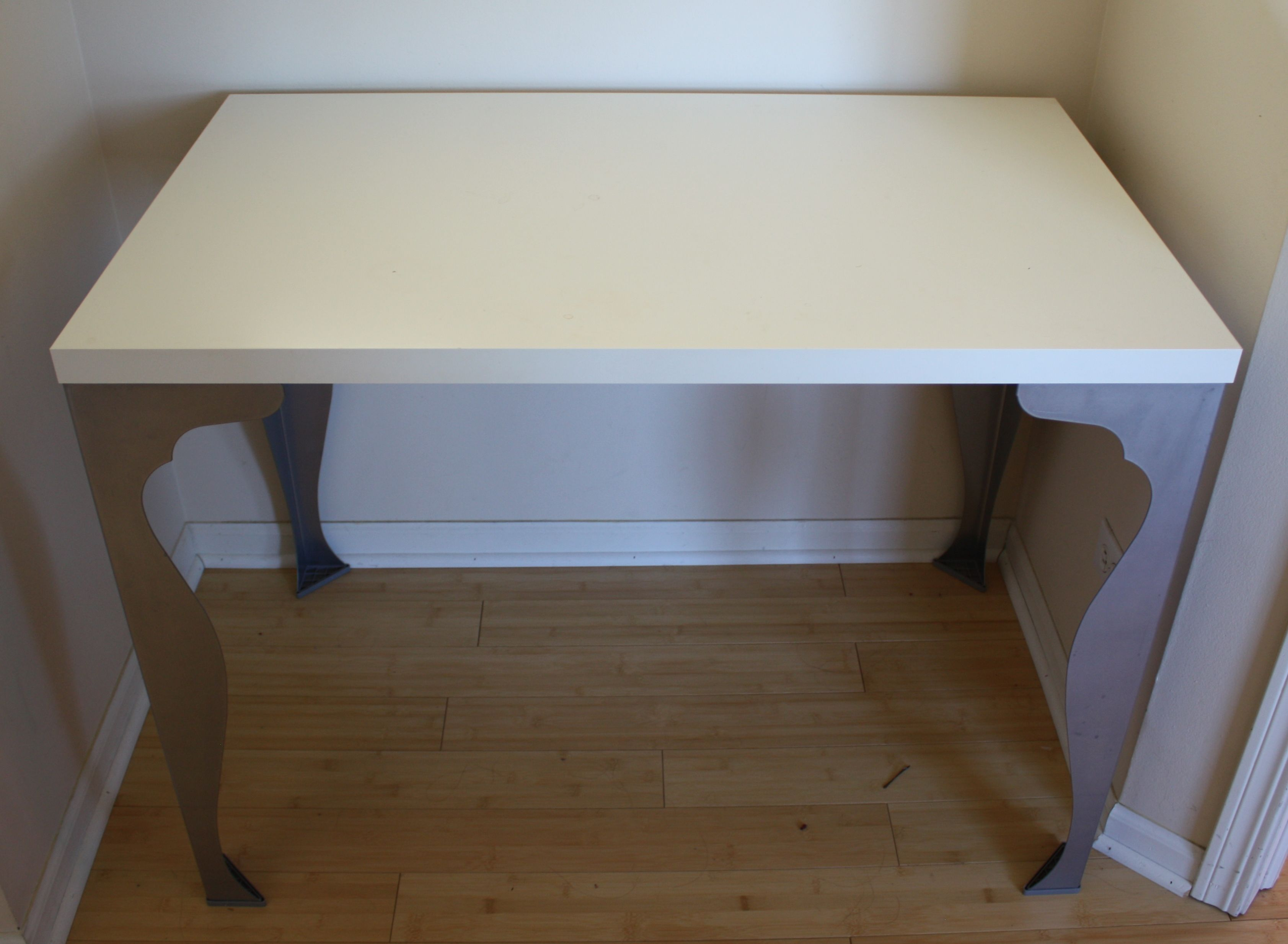 """SOLD - White Table Top w/ Powder Coated Steel Legs This clean white table top sits on highly sought after Ikea Vika Fintorp table legs. The legs have been discontinued. Smoke free home. Dimensions: 29"""" high - 24"""" deep - 39"""" wide www.relovedinteriors.com"""