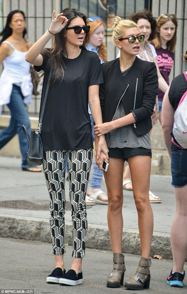 b58dc1de303c8 Call to attention  Kendall and Hailey s outfits certainly were eye-catching  with Kendall wearing art deco-print leggings and Hailey in shor.
