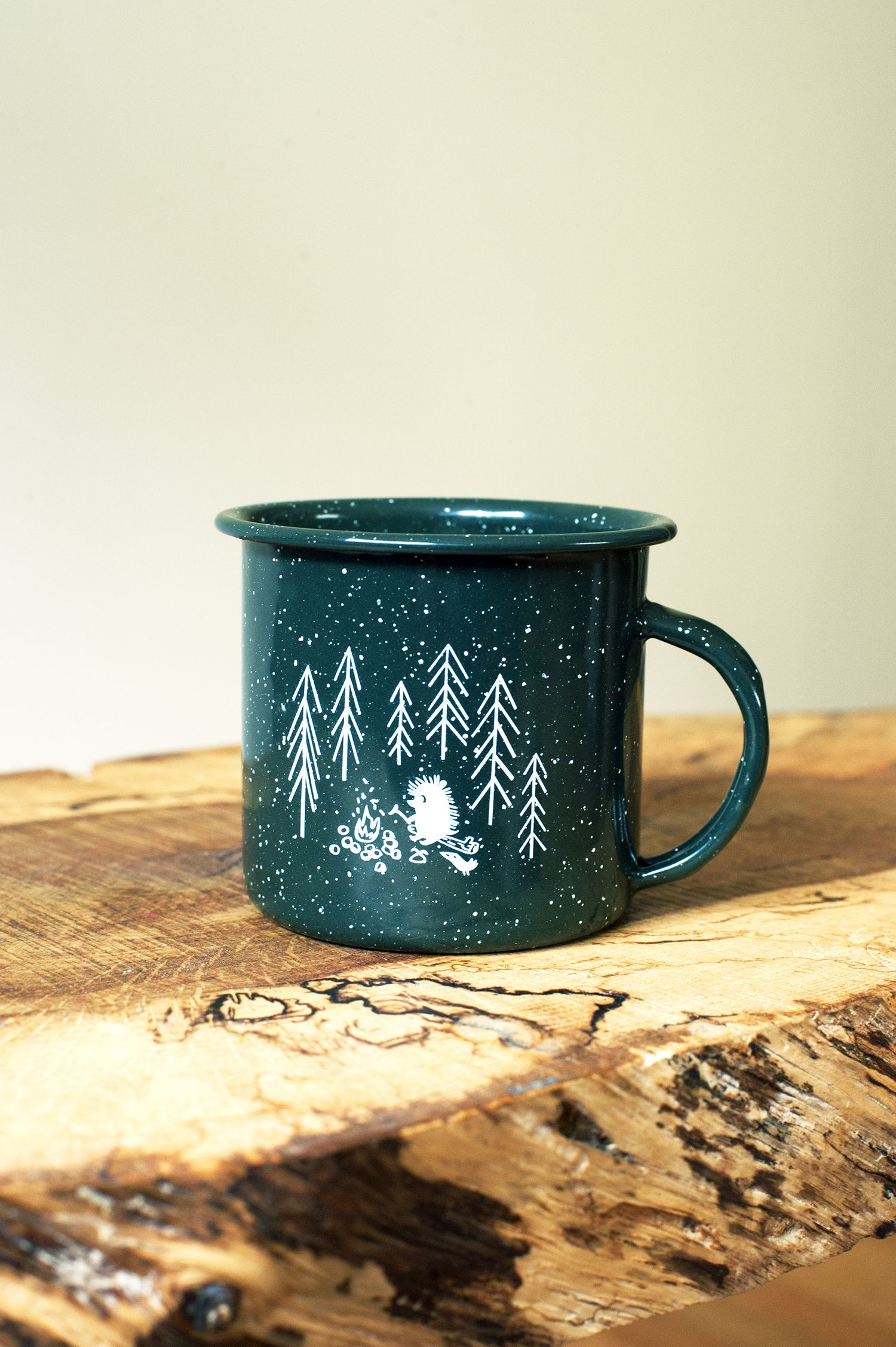 Forest & Waves's Green Pine Mug Candle does double duty. First, burn the fresh-scented candle, then use the cup for camping!