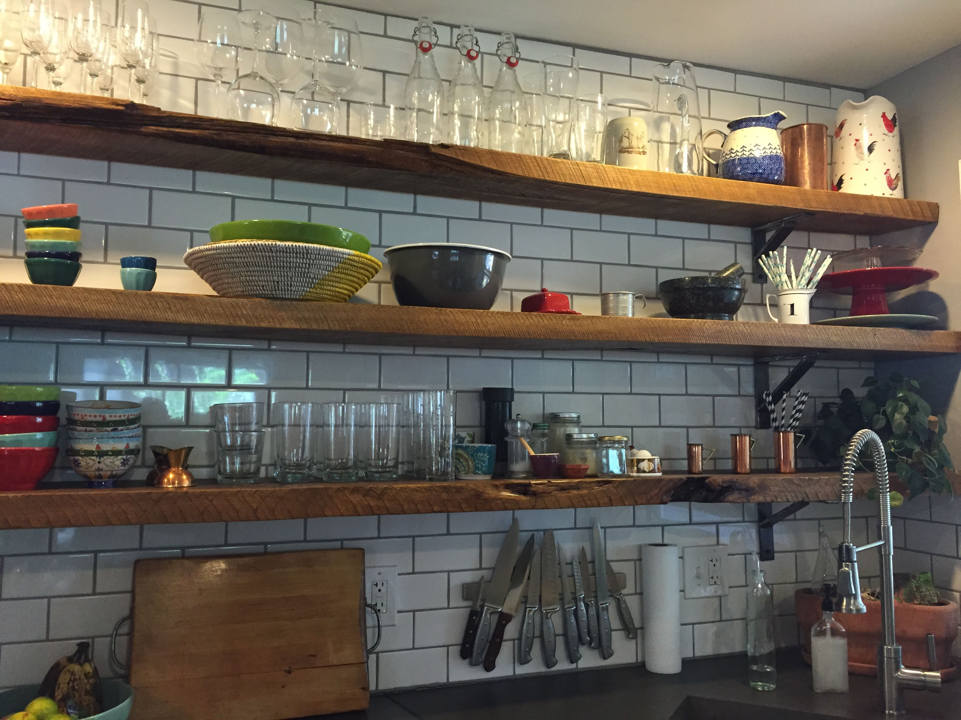 Love the white tile and wood shelves