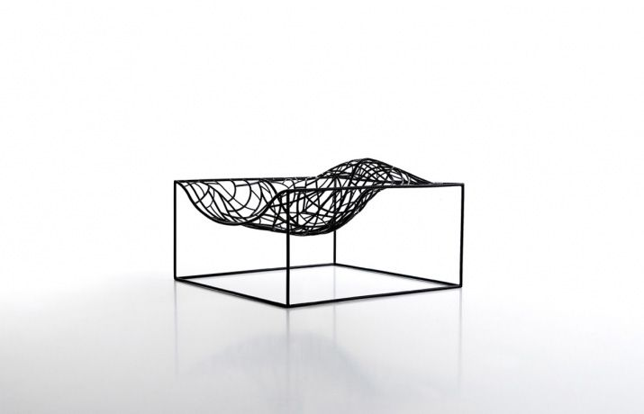Armchair Ad Hoc by Viccarbe This sculptural armchair features a black epoxy powder coated brass core and comes in several colours: the black, white or orange versions can also be used outdoors, while the gold lacquered one is only suitable for indoor use. Each Ad Hoc armchair is handcrafted and can be slightly different from others in the same serie.