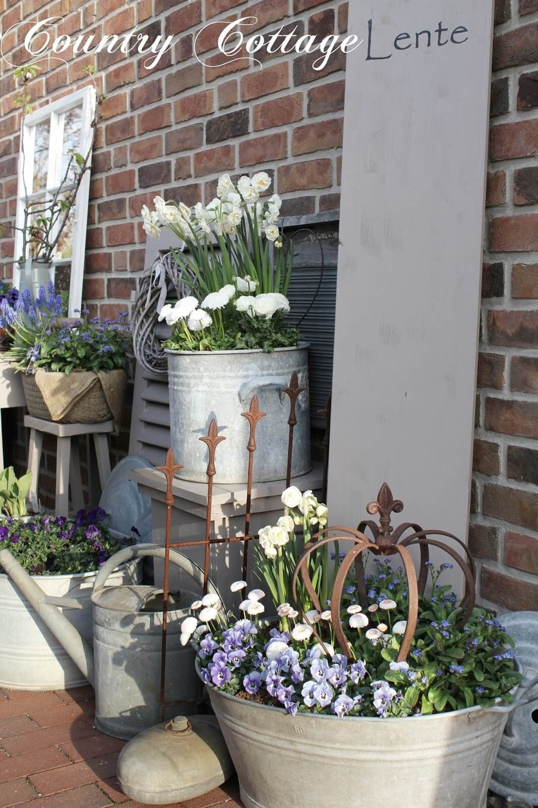 Photo of An Assortment of Metal Planters with Flowers