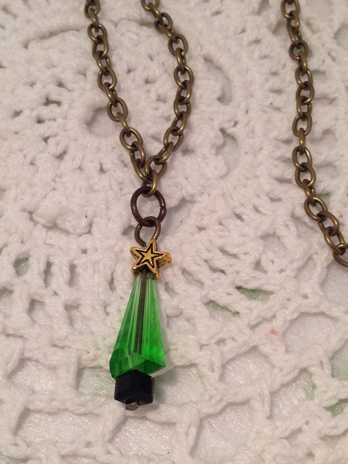 A personal favourite from my Etsy shop https://www.etsy.com/au/listing/256239025/christmas-tree-necklace-crystal