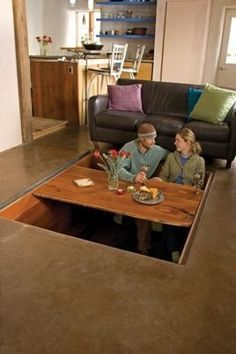 Hidden Dining Room Table  Kinda Crazy But Cool. Covered With Wood Planks  And A Coffee Table When Not In Use