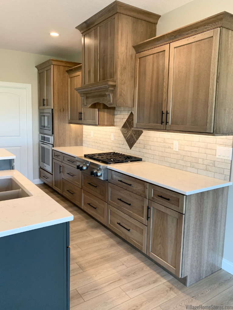 Dura Supreme Hickory Morel Finish Kitchen in a new home with kitchen design and materials by Village Home Stores for Hazelwood Homes | Village Home Stores Blog
