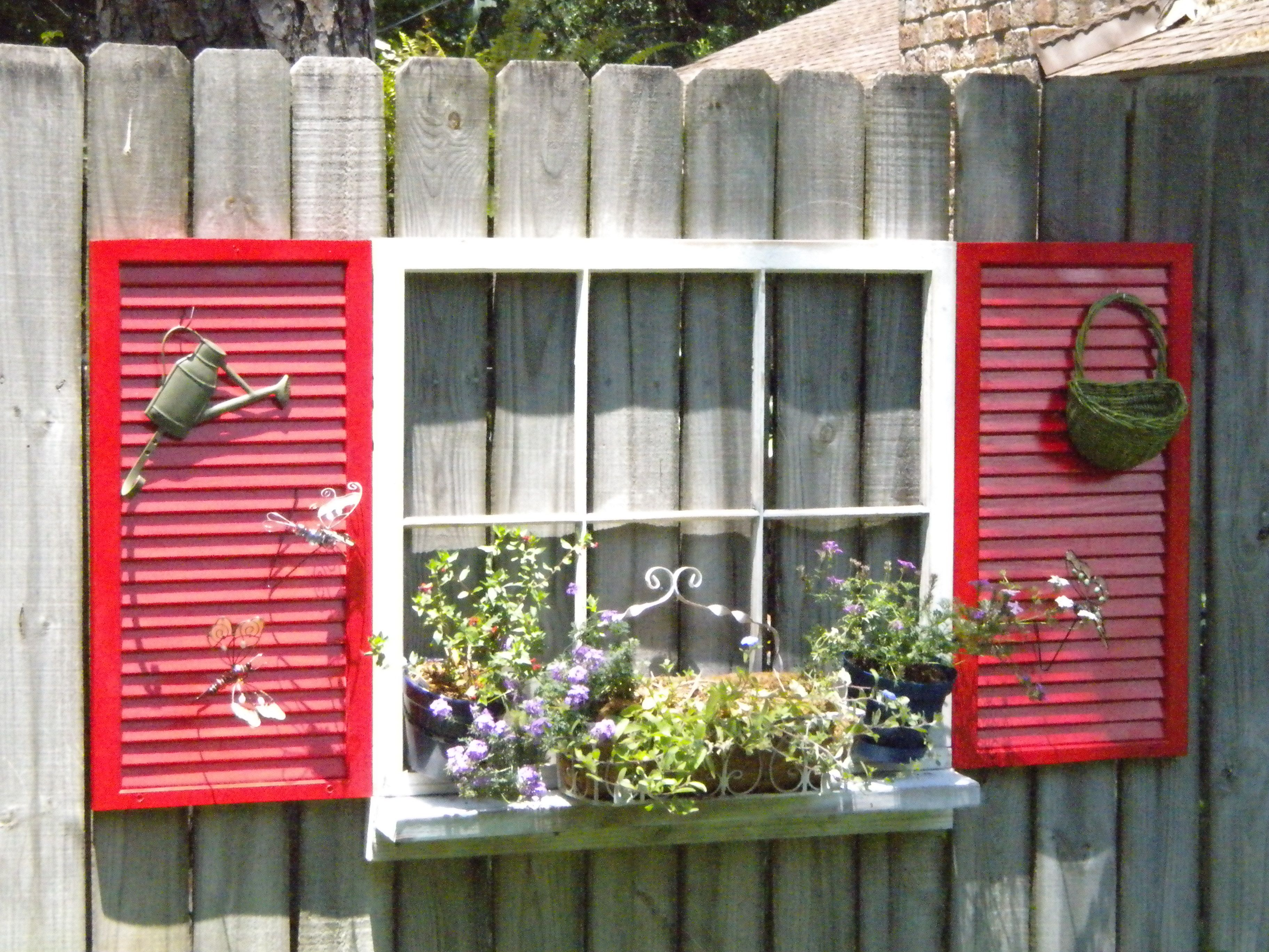 Window well decor  repurpose an old window and shutters to dress the fence  cafe inte