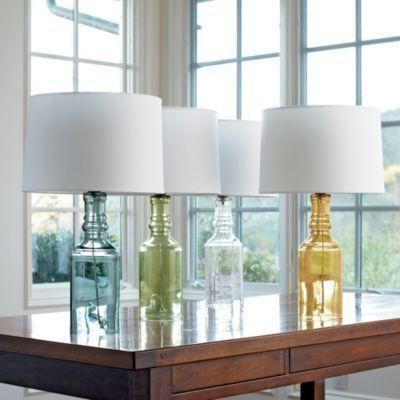 Glass table lamp is inspired by vintage pharmacy bottles. Clean, understated look is perfect in bedrooms or any space that needs a subtle glow. Inline switch. UL listed. 100W bulb (not... More Details