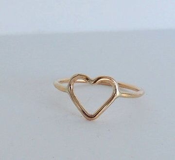 A personal favorite from my Etsy shop https://www.etsy.com/listing/73922658/golden-heart-midi-ring-band-14k-gold