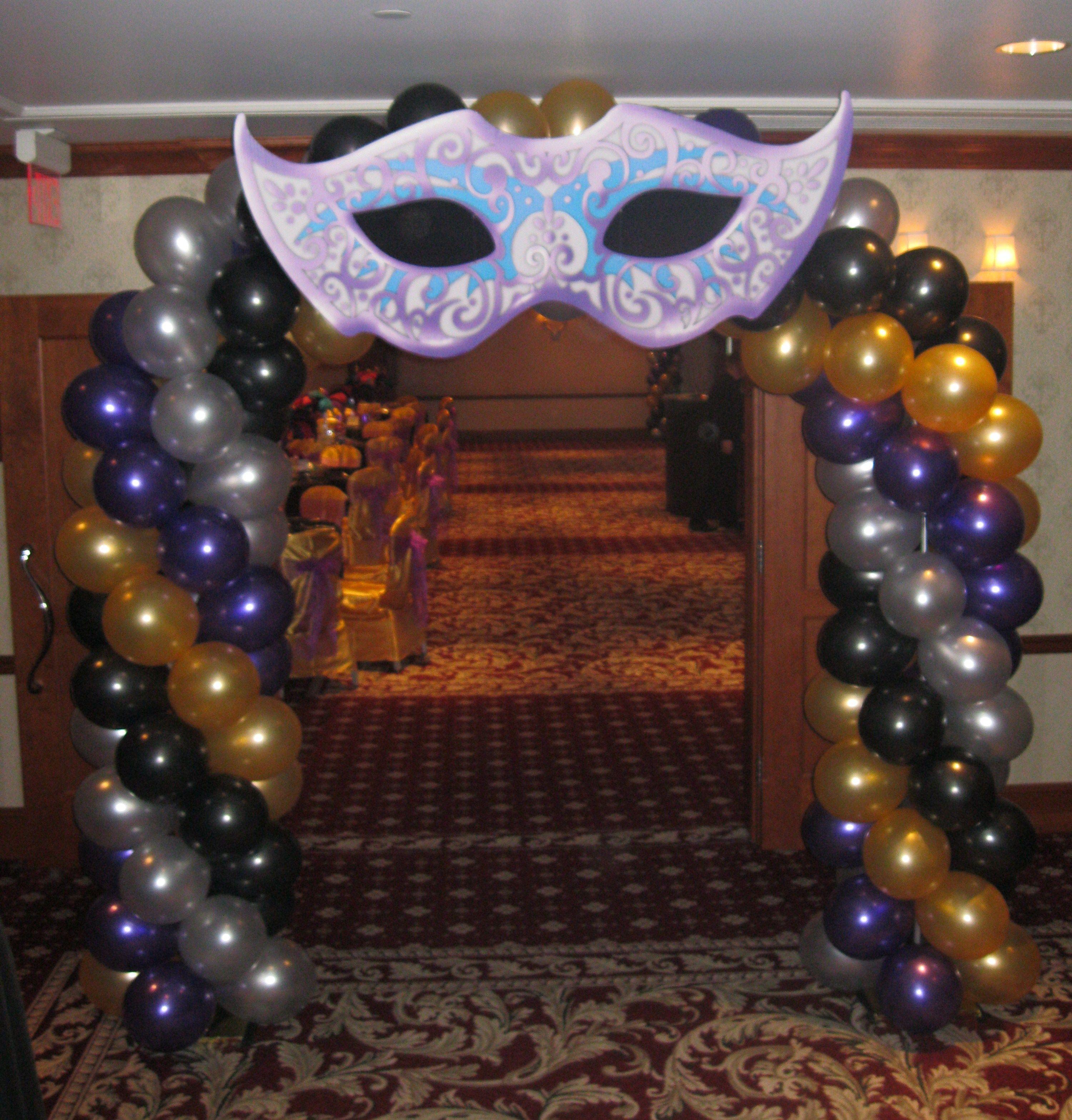 Walk through entrance mask balloon arch created by