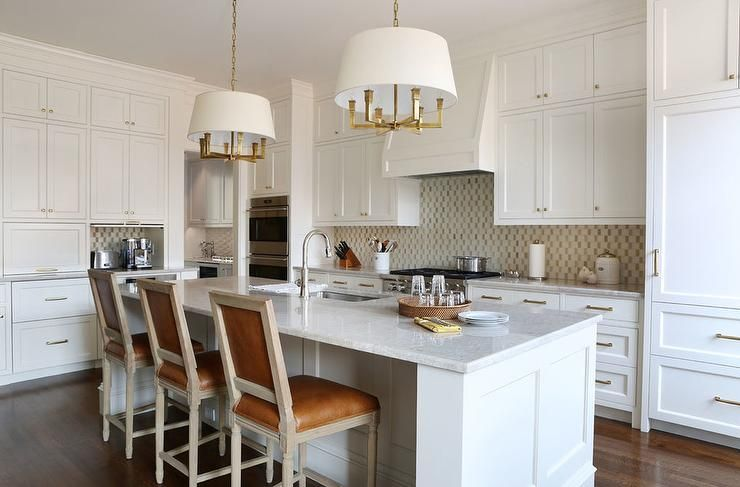 Elegant White Kitchen Features Two Six Light Square Tube Chandeliers Hung Above A White Islan Country Kitchen Designs Kitchen Design Traditional Kitchen Design