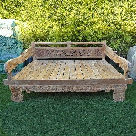 Rustic reclaimed teak wood daybed with intricate floral carving on back. Equip with roll bar. Left unfinished. Perfect for outdoors, custom cushions available.