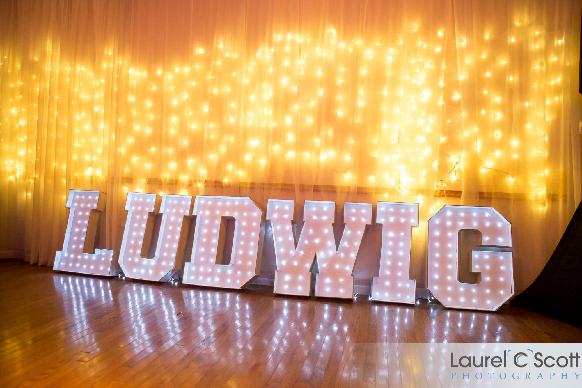 Last name light up letters Made of cardboard hot glue String
