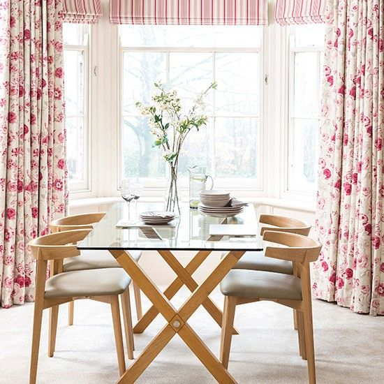 Large Floral Patterns Create A Homely Vintage Vibe In This Dining Room.