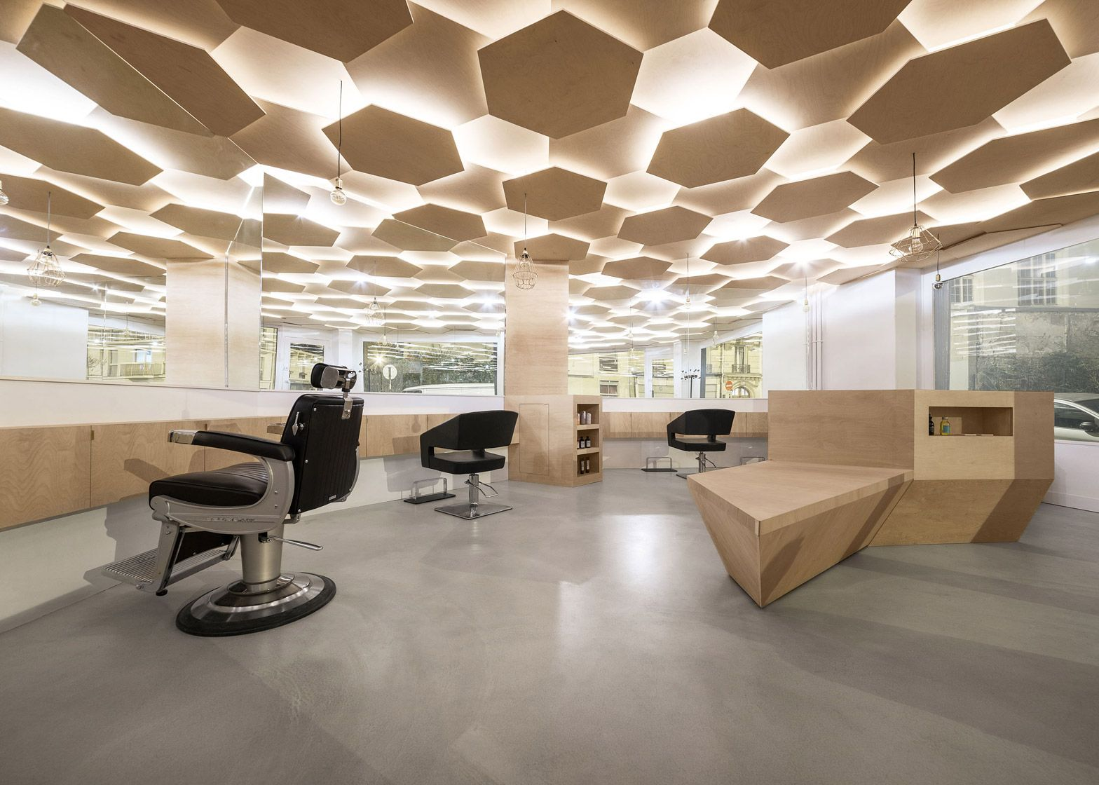 Sheets Of Plywood Were Layered To Create The Ceiling Within This Parisian Salon Which Architect