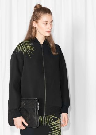 f5593f988443 Contemporary scuba-feel bomber jacket flaunting a palm leaf embroidery.