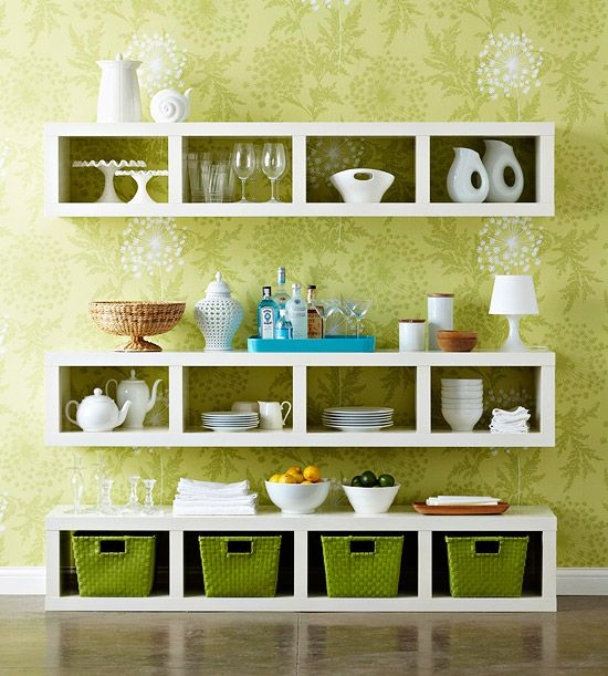 CLEVER!  Hang single wide bookshelves horizontally to create dining storage.  Middle one is huhg at counter height which then doubles at a serving buffet.  LOVE  From bhg