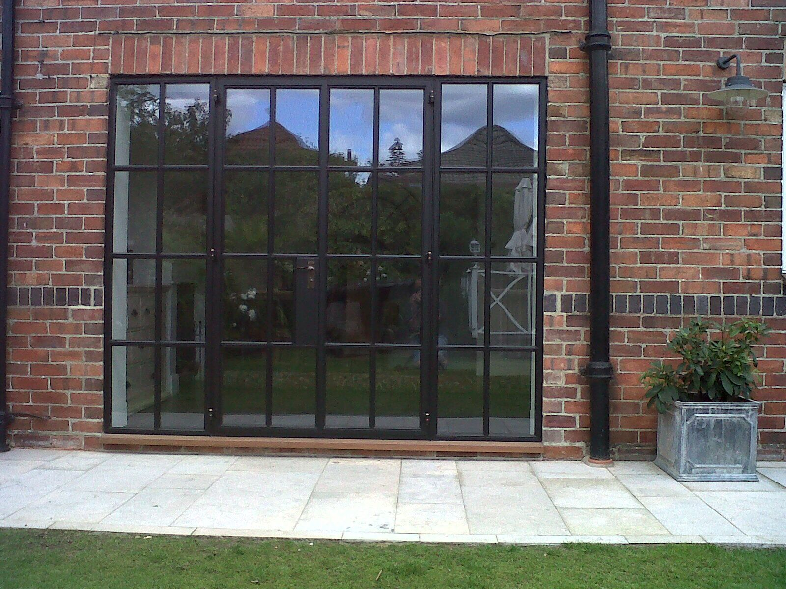French Exterior Doors Steel: Red Brick With Black Metal Windows