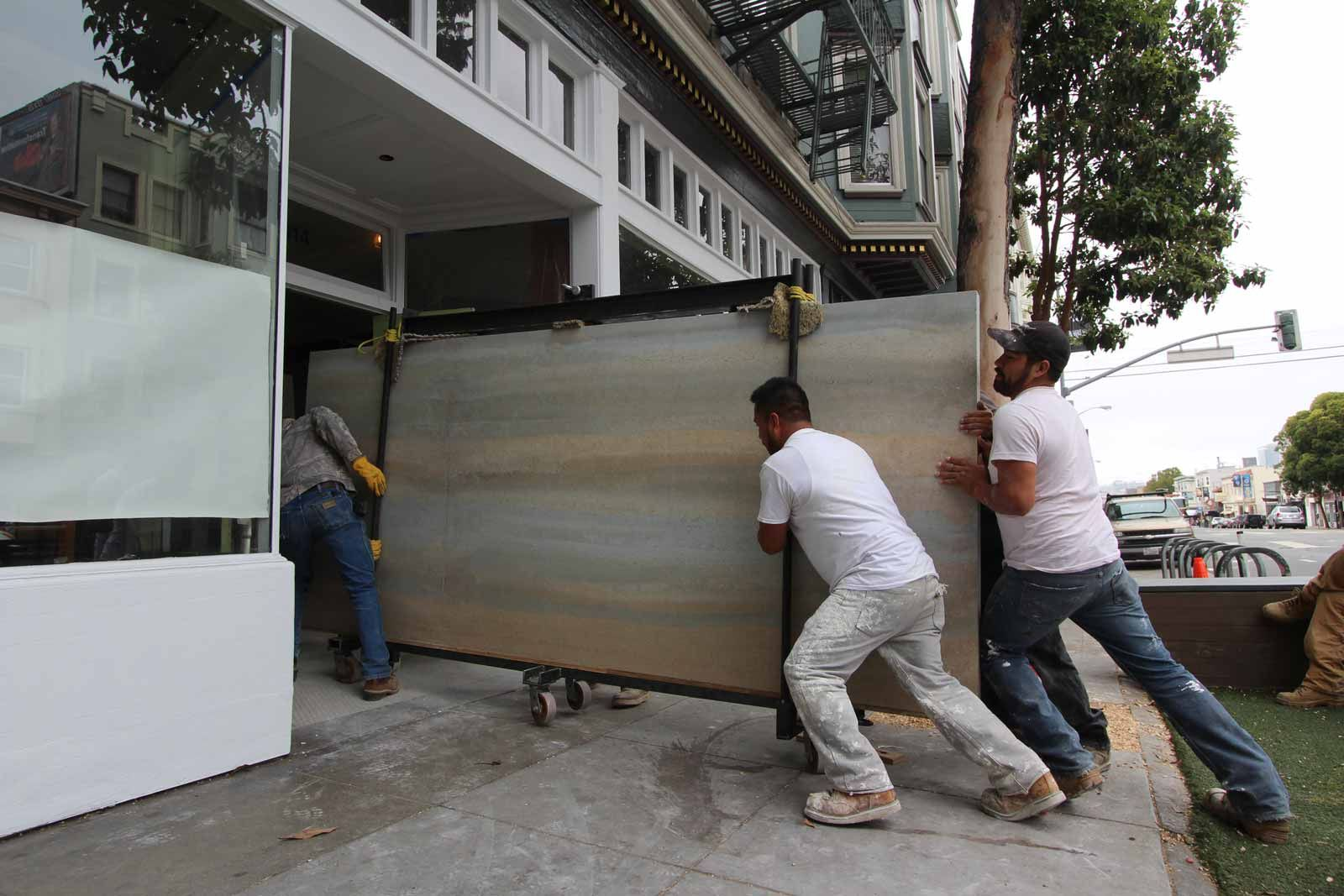 Another Way To Deliver Precast Rammed Earth Panels Uses Manpower To Go Right Through The Front Door Especi Rammed Earth Rammed Earth Homes Green Roof Building