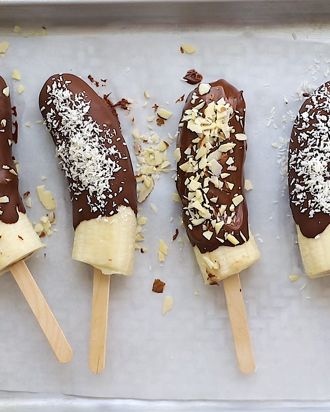These healthy chocolate covered banana pops are made with just four ingredients. Simple, refreshing and the perfect cool and creamy treat for summer.