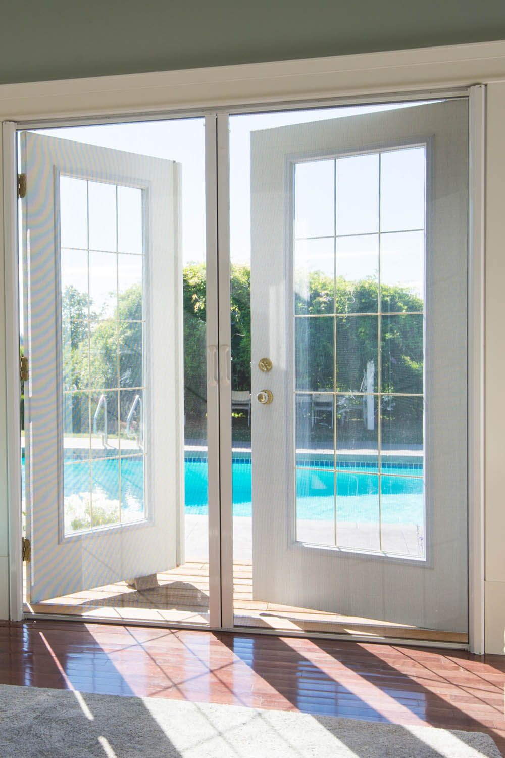 Phantom Screens Double French Doors Are Mounted To Each Side Of The Door Frame And Are Pulled To The Center Of The French Doors With Screens Double French Doors