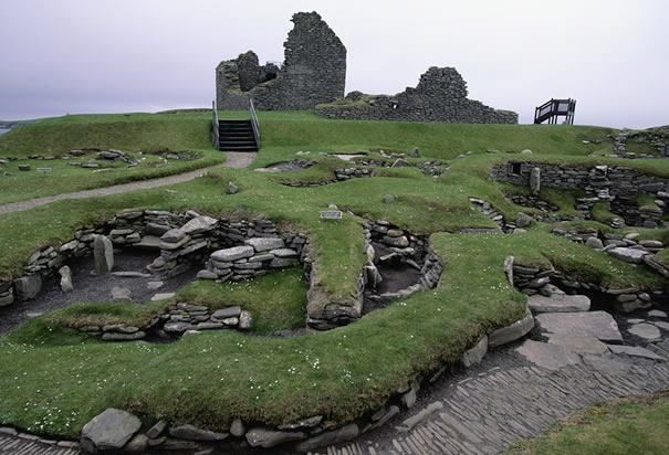 Ruins at Jarlshof: A path runs past the ruins of the old Viking settlement at Jarlshof in the Shetland Islands, Scotland. Vikings from Norway settled at Jarlshof in the 9th century. (Photo Credit: Wolfgang Kaehler/CORBIS) the houses you can see in the front of the photo are pre viking , the house at the back was built by the stuarts . the viking long houses are to the right . don't think you can see them in this photo .