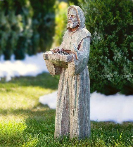 "Earth-Tone Resin-Cast Saint Francis Statue with Bird Feeder   $69.95 + $11.99 shipping  Cast resin with hand-carved look •Weather resistant •32"" tall Plowandhearth.com"