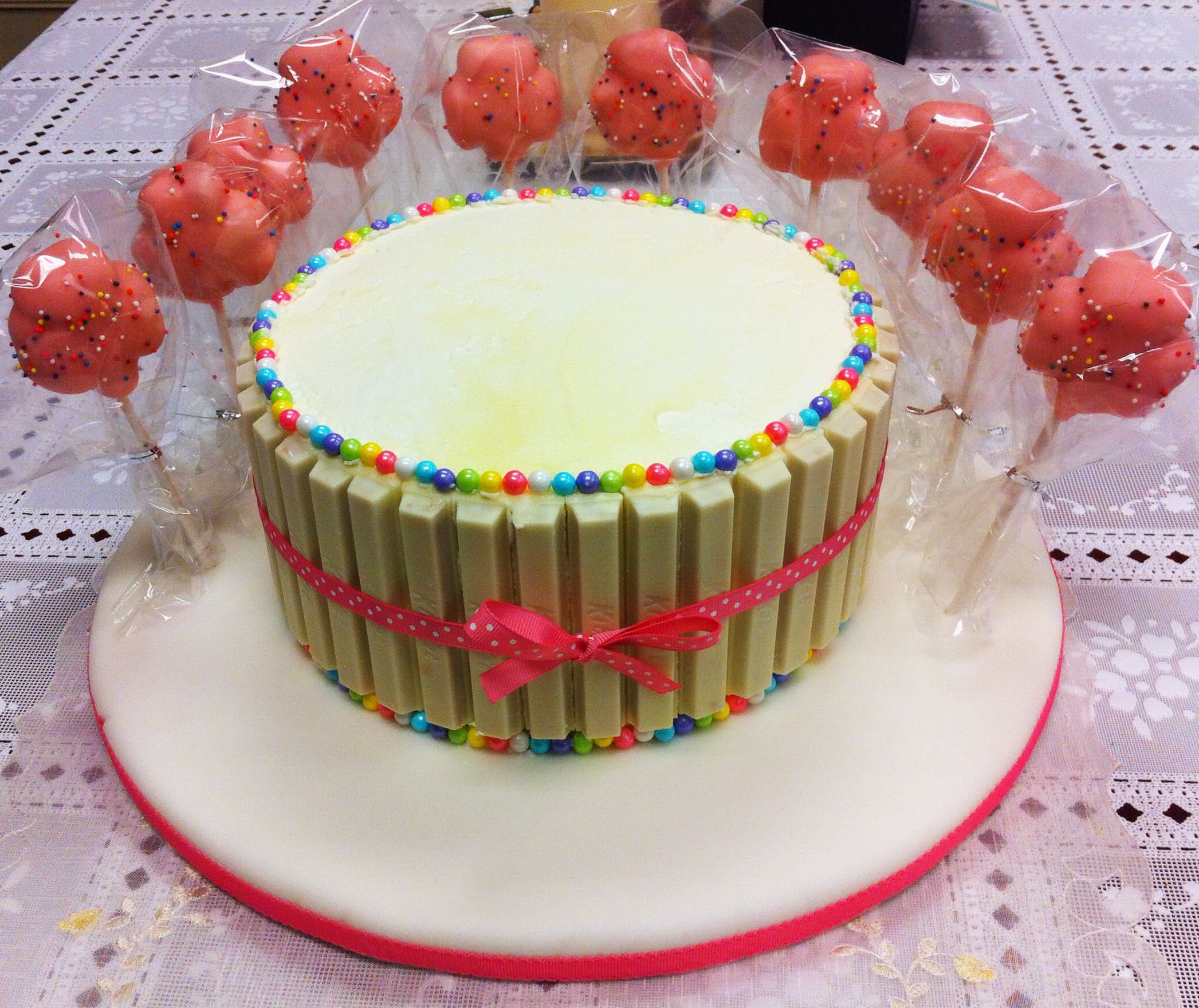 White KitKat Birthday cake for a girl look at the pink shamrock