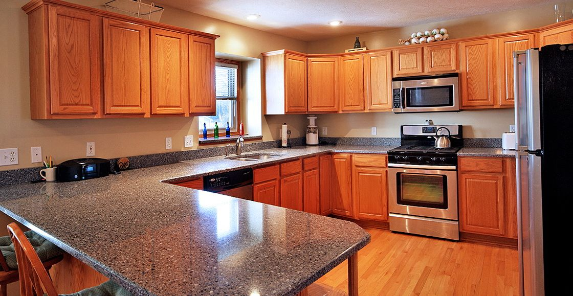 Red Quartz Countertops Updating Oak Kitchen Cabinets Oak