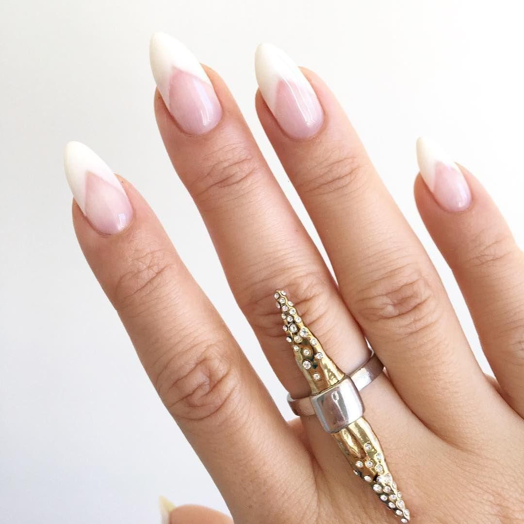 Pointed nails look extra sharp and chic with a deep V french