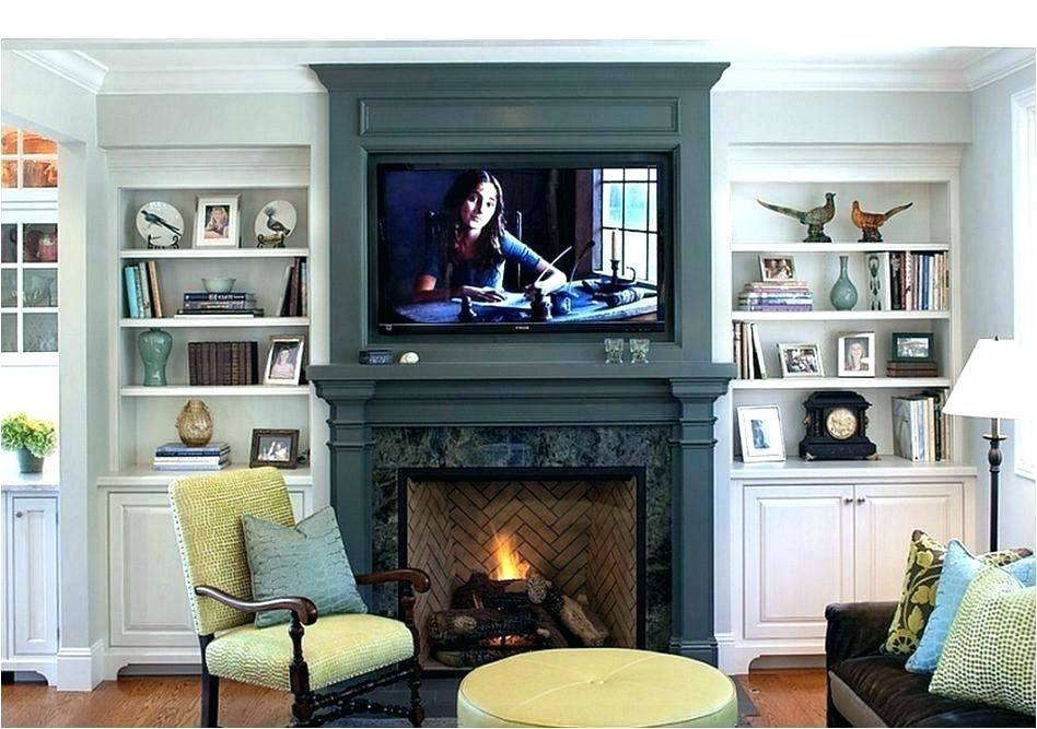 Height To Mount Tv Over Fireplace Mounting On Fireplace How To Mount Above Fireplace Traditional Liv Traditional Family Rooms Family Room Fireplace Bookshelves