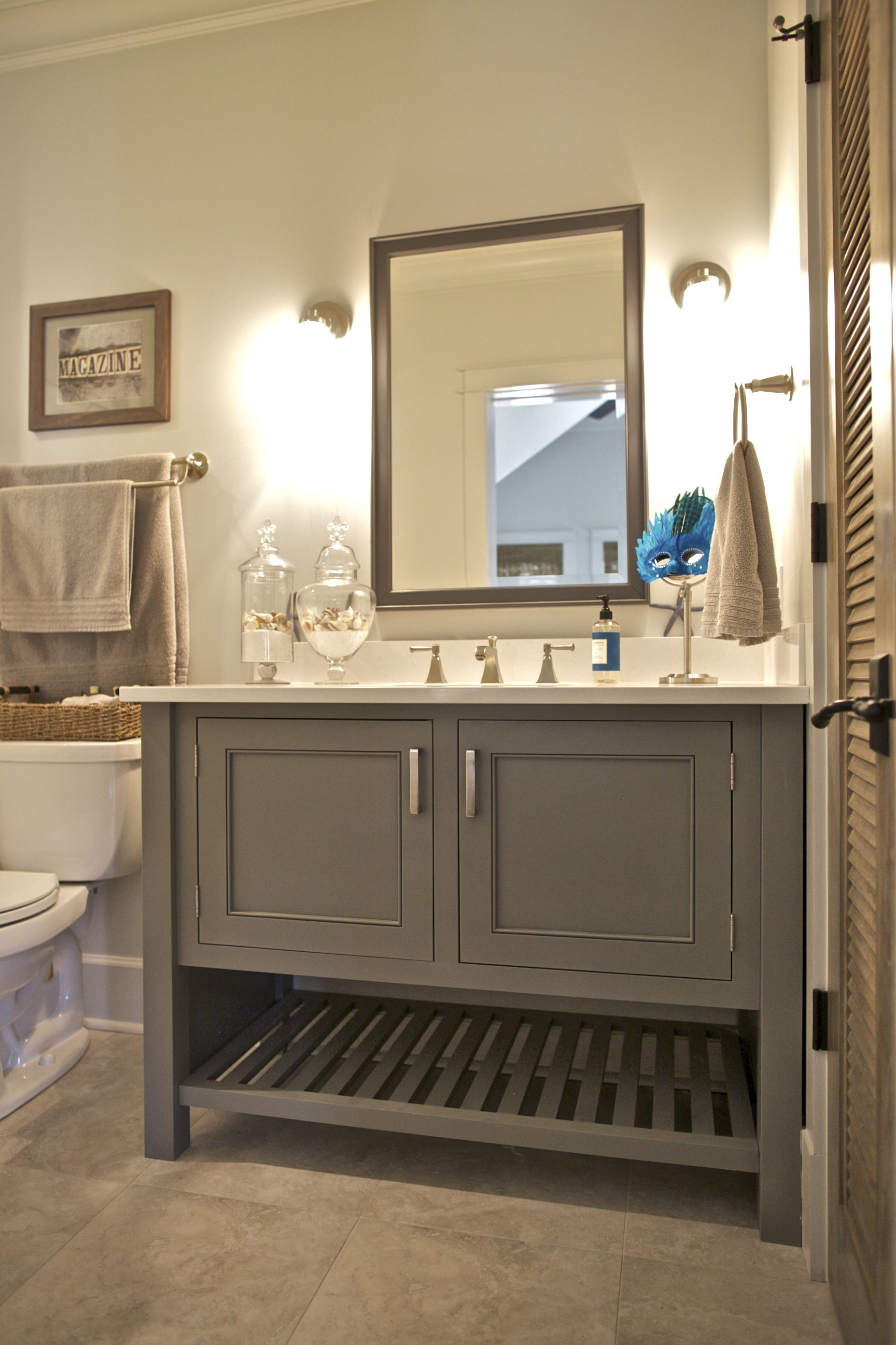 This bathroom features a painted maple inset cabinet vanity in a popular  warm gray color.