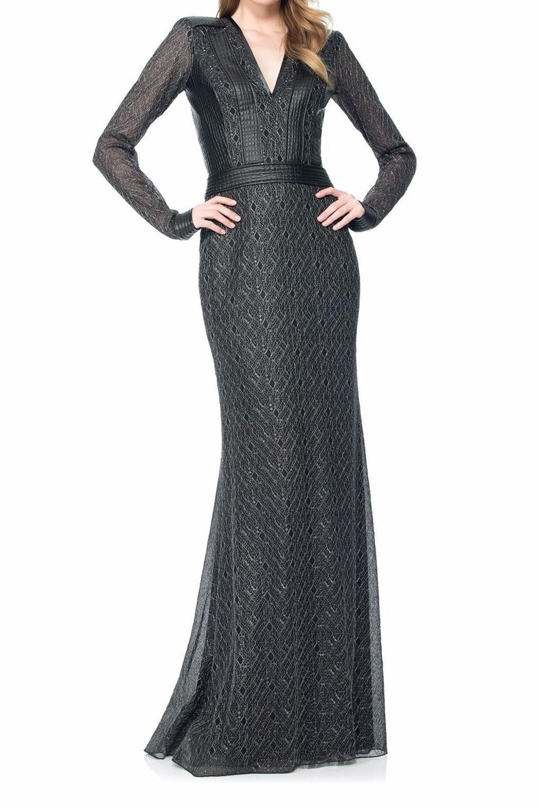 b37e261dde1b Long Sleeve Marta Lace Gown. Dress has Illusion Sheer Long Sleeves, and a  Banded Leatherette Waist and Cuffs. It has a Metallic Lace Diamond Motif  Overlay.