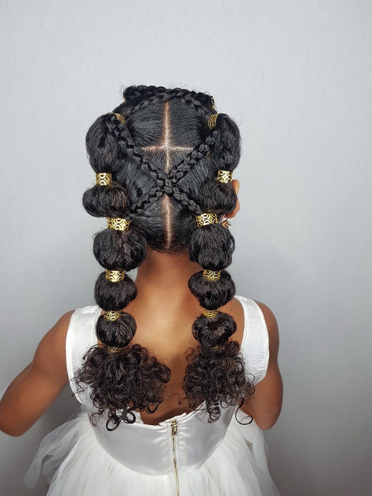 Poodlepuffs ponytails hairstyles for curly little girls