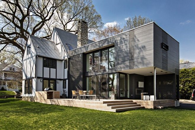 This glass-and-steel rectangular box is a modern addition to a Tudor home
