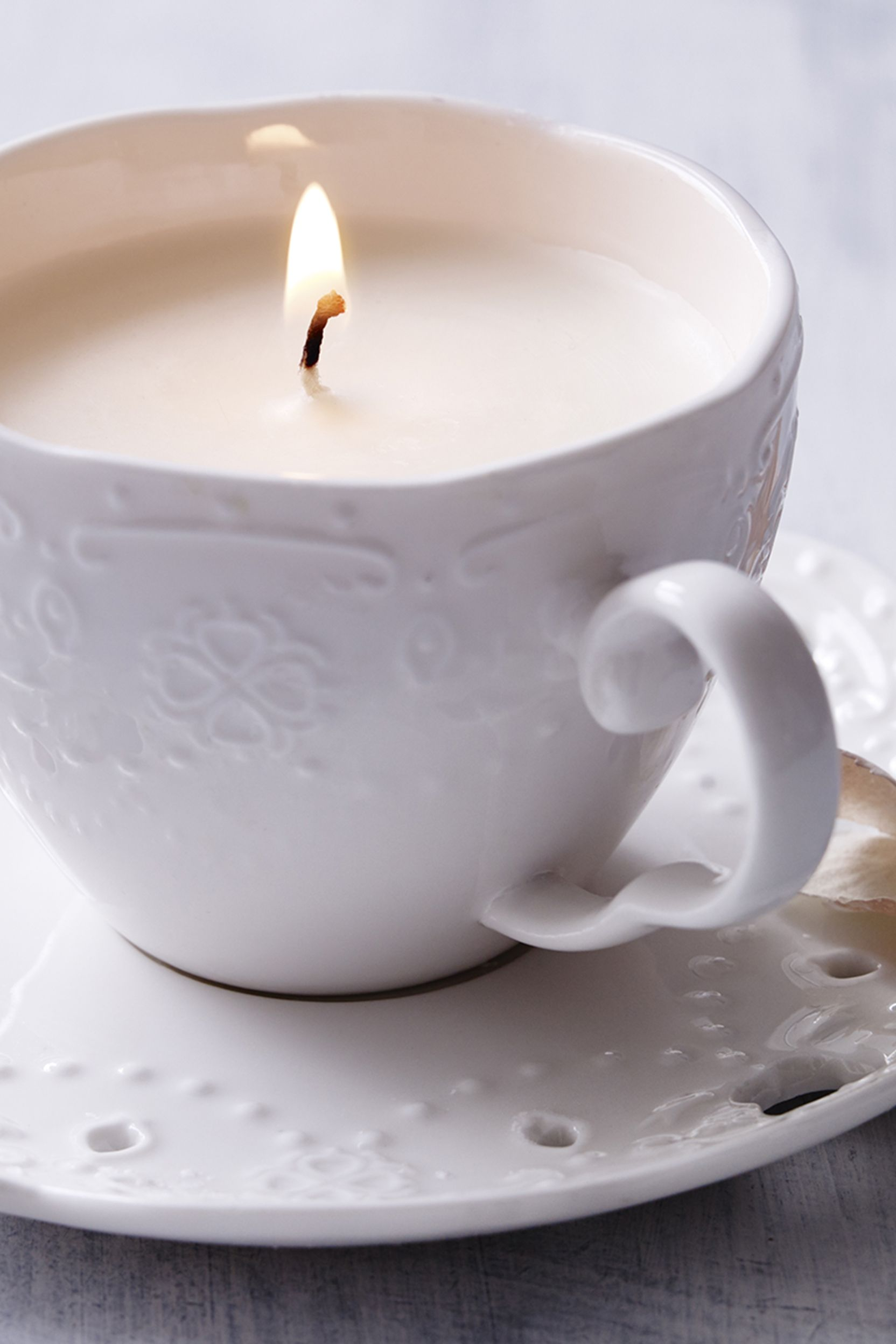 A twist on a family home favourite - a candle in a tea cup is super-chic, modern yet sophisticated.