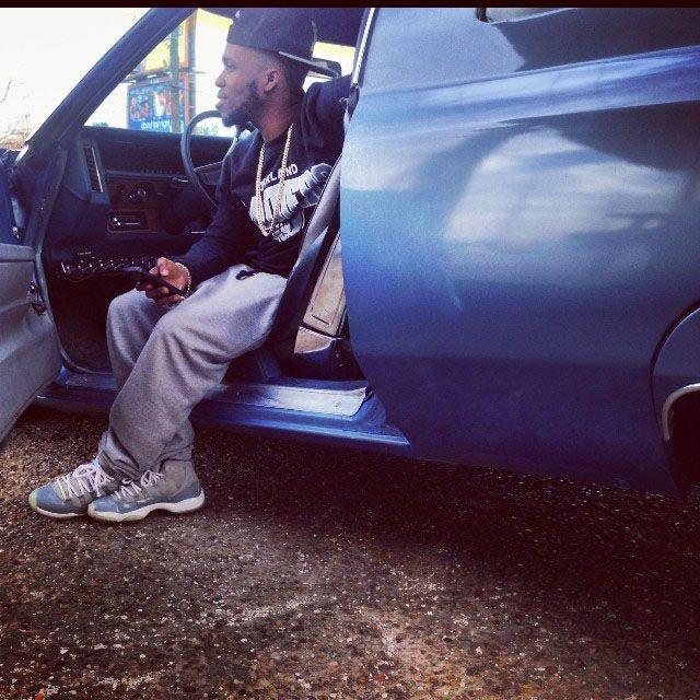 Currensy wearing Air Jordan 11 Retro Cool Grey