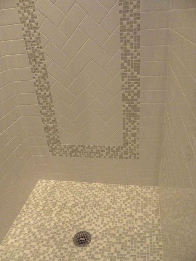 White Subway Tile With Glass And Stone Accent Shower Floor And