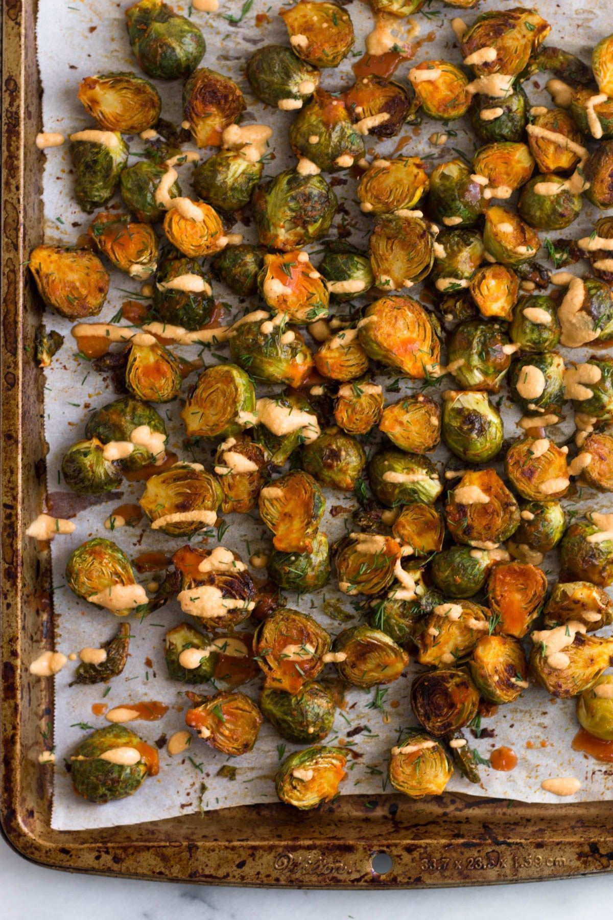 Cheesy Buffalo Brussel Sprouts #buffalobrusselsprouts Vegan and Whole30 approved, these Cheesy Buffalo Brussel Sprouts will be a sure hit! Perfect for an appetizer, side dish, or for game day snacking! Dairy free, paleo, and gluten free too - Eat the Gains #brusselsprouts #vegan #paleo #glutenfree #whole30 #buffalobrusselsprouts Cheesy Buffalo Brussel Sprouts #buffalobrusselsprouts Vegan and Whole30 approved, these Cheesy Buffalo Brussel Sprouts will be a sure hit! Perfect for an appetizer, si #buffalobrusselsprouts
