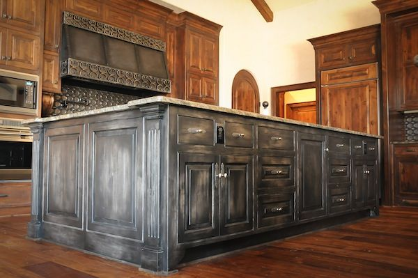 A Kitchen Island Stained In Ebony Then Dry Brushed With