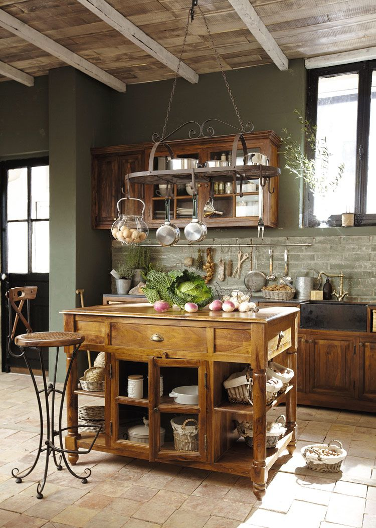 island pot rack farm sink and exposed beams
