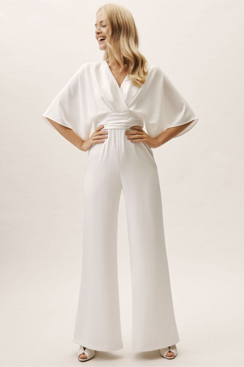 33 Bridal Jumpsuits And Rompers For Your Elopement Or Minimony White Jumpsuit Wedding Wedding Pantsuit Wedding Pants
