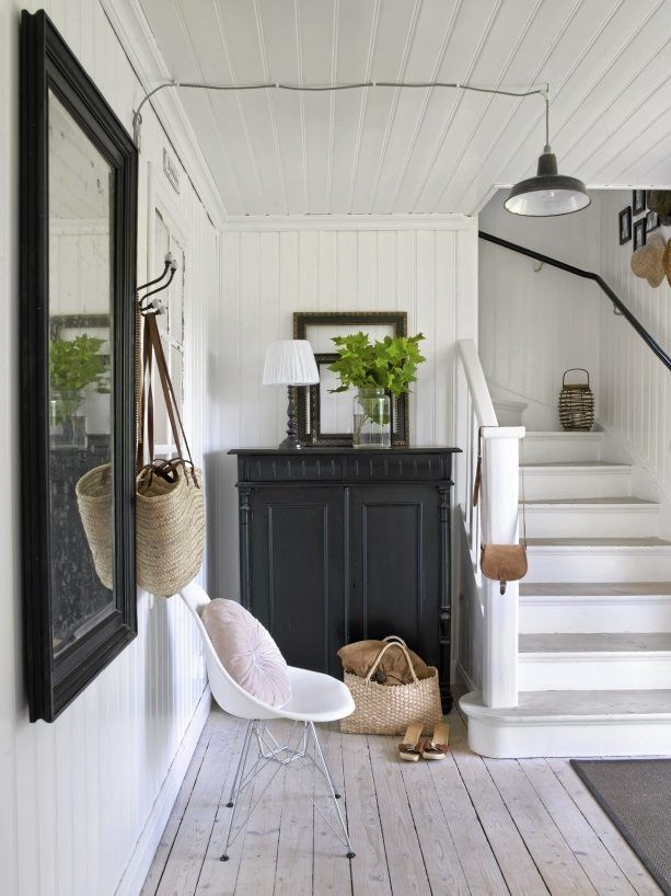 Love this cottage entryway with bead-board and black accents.  #entryways  #foyers homechanneltv.com