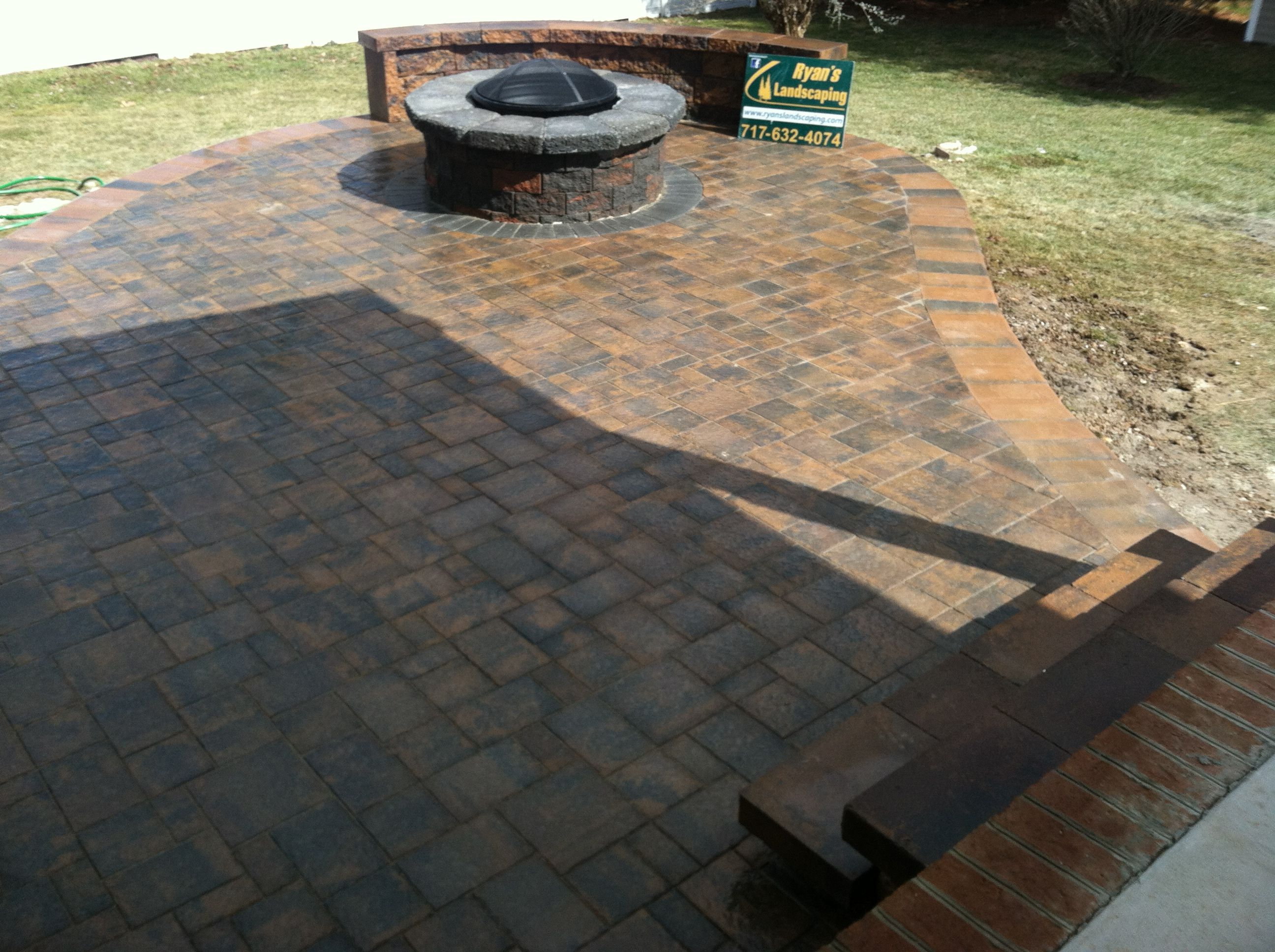 Hanover Paver Patio Installation Featuring A Fire Pit With A Brick Ring Of  Charcoal Colored Brick