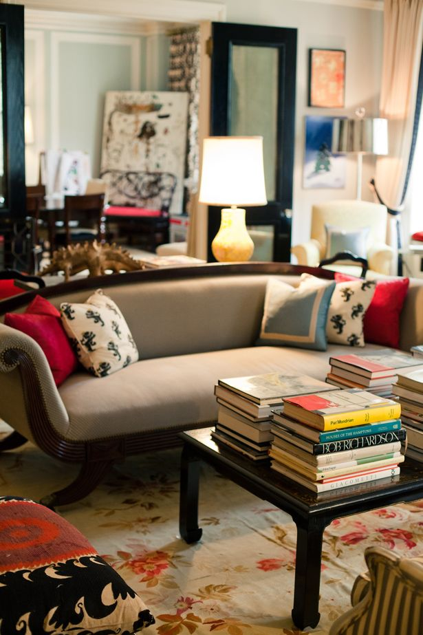 A table full of book, as in Kate Spade's home. via From Me to You Tumblr.