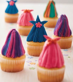 DIY: How To Make A Colorful and Crazy Haired Cupcake. Great idea for a Trolls- themed birthday party.