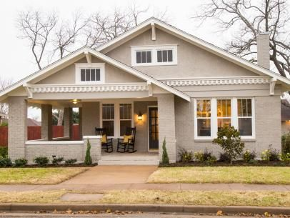 Painted Brick Bungalow Style House With White Dentil Moulding